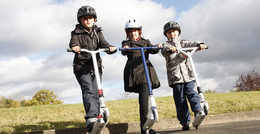 Three Kids On Scooters